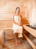 Woman in towel relaxing at steamed finnish sauna — Stock Photo