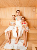 Mother with daughters relaxing at steam bath — Stok fotoğraf