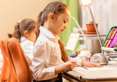 Little girls drawing pictures — Stock Photo