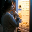 Woman looking in the refrigerator at late evening — Stock Photo #44227585