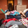 Girl in mask, snorkel and flippers sitting in big suitcase — Stock Photo #44462643