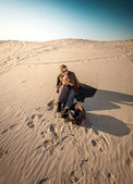 Woman with bag lost in desert  — Stock Photo