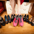 Female picking sneakers rather than black shoes — Stock Photo #44781117