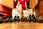 Motion blur of woman sitting in wardrobe with black high heeled  — Stock Photo