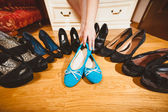 Woman picking ballet flats rather than high heels — Stock Photo