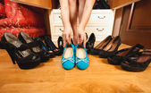 Woman choosing comfortable flats rather than high heels — Stock Photo