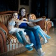 Family with kids watching TV at late evening — Stock Photo