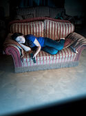 Woman sleeping on sofa while watching TV — Stock Photo