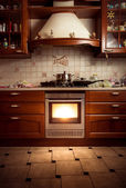Photo of country style kitchen with hot oven — Stock Photo