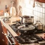Photo of metal saucepan boiling on stove — Stock Photo #45455439