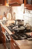 Photo of metal saucepan boiling on stove — Stock Photo