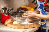 Photo of housewife cracking egg with knife — Stock Photo