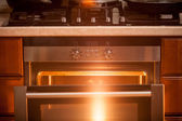 Photo of open incandescent open oven  — Stock Photo