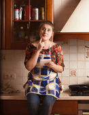 Portrait of housewife remembering recipe of dish — Stock Photo