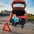 Depressed man leaning against broken car — Stock Photo