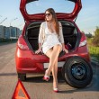 Woman in short dress waiting for help near broken car — Stock Photo #45545457