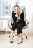 Businesswoman choosing between high heeled shoe and ballet flat — Stock Photo