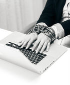 Closeup photo of woman locked to laptop by chain — Stock Photo
