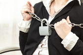 Photo of businesswoman being locked by chain and padlock — Stock Photo