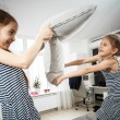 Portrait of two little sisters fighting with pillows — Stock Photo #46283557