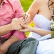 Photo of young bride putting wedding ring on grooms hand — Stock Photo #46820345
