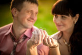 Portrait with selective focus on wedding rings held by smiling c — Stock Photo