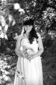 Monochrome portrait of happy smiling bride at park — Stock Photo