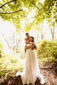 Toned photo of beautiful newly married couple hugging under tree — Stock Photo