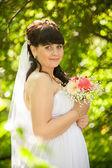 Portrait of cute brunette bride at summer park — Photo