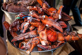 Frozen lobster claws in metal bucket at restaurant — Stock Photo