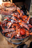 Lobster claws at metal bucket at kitchen — Stock Photo