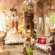 Classic french interior with mirrors, lamps and sofas — Stock Photo #50036819