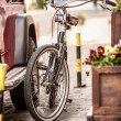 Photo of vintage bike parked on old street — Stock Photo #50037075