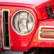 Постер, плакат: Headlight of red SUV