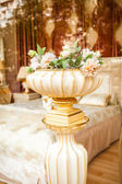 Antique porcelain vase with flowers at classic interior — Stock Photo