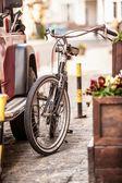 Photo of vintage bike parked on old street — Stock Photo