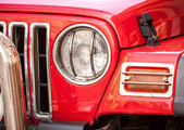 Headlight of red SUV — Stock Photo