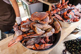 Frozen crabs and lobster claws at restaurant kitchen — Stock Photo