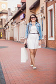 Woman having shopping and walking on old street — Stock Photo