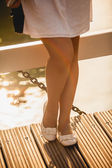 Photo of beautiful woman legs in ballet flats on bridge — Stock Photo