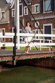 Woman standing on european wooden bridge — Stock Photo