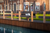 Woman with tablet on bridge at Amsterdam — Stock Photo