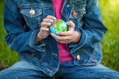 Photo of little girl holding globe and exploring it — Stock Photo