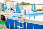 Inflatable swimming pool with metal frame on beach — Stock Photo