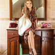 Girl in mothers clothes sitting on sink at bathroom — Stock Photo #50940825