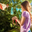 Photo of young girl drying clothes on clothesline — Stock Photo #50944121