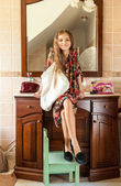 Girl in mothers clothes sitting on sink at bathroom — Foto de Stock