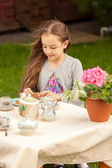 Girl drinking tea at yard at windy weather — Stock Photo