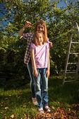 Mother hanging daughter on string with clothespin — Stock Photo