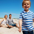 Charming Kid with Mom and Dad on Vacation — Stock Photo